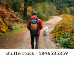 A Hiker In A Red Coat And Brown ...