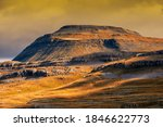 Ingleborough is the second-highest mountain in the Yorkshire Dales, England. It is one of the Yorkshire Three Peaks, and is frequently climbed as part of the Three Peaks walk.