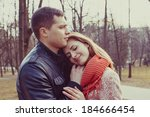 young happy couple hugging in... | Shutterstock . vector #184666454