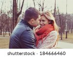young happy couple hugging in... | Shutterstock . vector #184666460