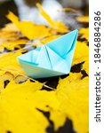 Paper Boat On A Water Surface...