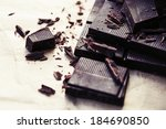 Small photo of Chocolate pieces. Chopped dark chocolate closeup