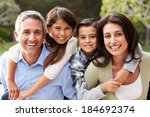 portrait of hispanic family in... | Shutterstock . vector #184692374