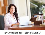 hispanic woman using laptop on... | Shutterstock . vector #184696550