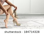 gold shoes and woman legs  | Shutterstock . vector #184714328