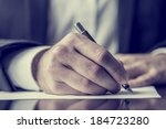 man signing a document or... | Shutterstock . vector #184723280
