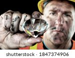 A Dirty Diamond Miner Covered...