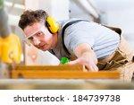 carpenter working on an... | Shutterstock . vector #184739738