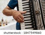 Accordion. Keys. Male Hand On...