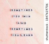 Small photo of Sometimes you win and sometimes you learn letter beads word typography