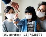 japanese family in face mask... | Shutterstock . vector #1847628976