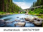 Small photo of Forest river bridge landscape. Bridge over forest river. Forest river bridge view. Bridge in forest