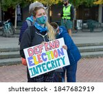 Small photo of San Francisco, CA - Nov 4, 2020: Unidentified participants of the DEFEND THE VOTE rally in San Francisco. Holding sign stating DEFEND ELECTION INTEGRITY.