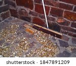 Wide Broom Against A Wall With...