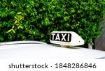 White Taxi Sign On A Car Roof...