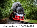 Small photo of Steam train on railroad ride. Locomotive. Steam train