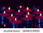 Several Small Burning Candles....