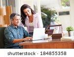 hispanic couple using laptop on ... | Shutterstock . vector #184855358