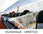 Reading newspaper in a plane - stock photo