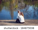 mother and daughter sitting... | Shutterstock . vector #184875038
