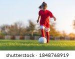 Girl Kicks A Soccer Ball On A...