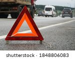 A warning road sign for an...