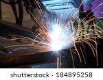 a welder joining metal | Shutterstock . vector #184895258