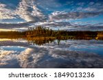 Small photo of Sunset over a lake in northern Sweden, near Dorotea