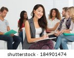 smiling woman taking notes... | Shutterstock . vector #184901474