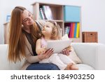 mother and baby playing games... | Shutterstock . vector #184903250