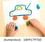 Children's Hands Sculpt A Car...