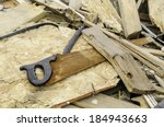 A Rusty Handsaw Lies Amid...