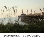 Fishing Pier And Sea Oats From...