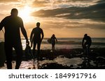 Silhouettes Of A Group Of...