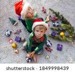 Toddler Girl And Boy In Santa...