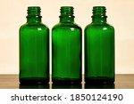 Three Empty Green Glass Bottles ...