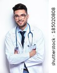young male medic standing with... | Shutterstock . vector #185020808