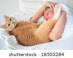 Stock photo woman and her cat relaxing in bed together 18503284