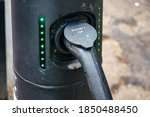 Electric Car Cable Plugged Int...