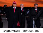 Small photo of 11/09/2020,USA:President Donald Trump and Vice President Mike Pence arrive for a campaign rally at Cherry Capital Airport,in Traverse City,with White House chief of staff Mark Meadows,right.