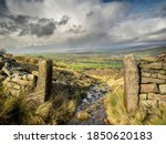 An Old Dry Stone Wall With...