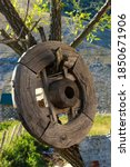 A Wooden Wheel Hung On A Tree...