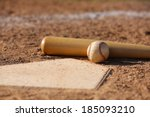 Baseball And Bat At Home Plate...