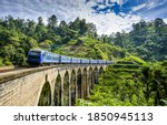 Small photo of Mountain forest railway bridge train ride. Mountain railway bridge train ride. Railway bridge train ride. Train ride on railway bridge