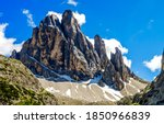 Mountain peak and blue sky clouds. Mountain peak view. Mountain peak landscape. Mountain rock peak