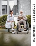 Handicapped aged man reading...