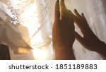 hands pulling a window curtain... | Shutterstock . vector #1851189883