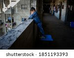 Small photo of Saida-Lebanon. Young child on an abandoned construction site occupied by Syrian refugees Saida-Lebanon on 2015-10-13