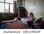 Small photo of A woman on his room inside an abandoned construction site occupied by Syrian refugees Saida-Lebanon on 2015-10-13