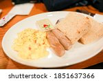 scrambled eggs  sausages and... | Shutterstock . vector #1851637366